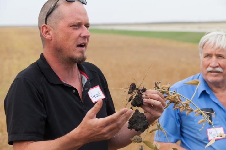 Grant Dyckof Artel Farmsshares about soybeans with harvest celebration guests.