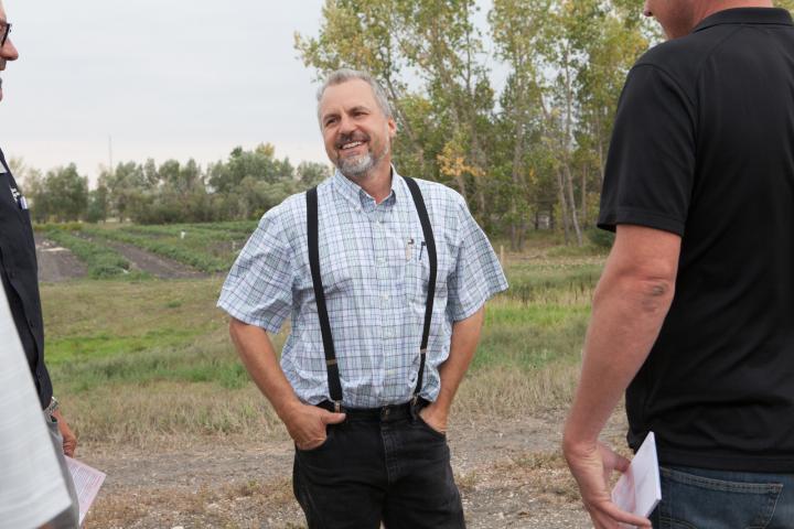 Victor Kleinsasser leads a colonytour for harvest celebration guests.