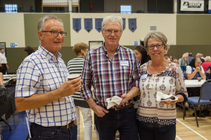 Ed Barkman, Grow Hope ambassador, with Robert and Ellen Stevenson, Grow Hope farmers from Kenton.