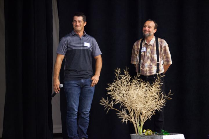 Kyle Friesen, ofH & M Farms in Altona, and Edward Wolman, Silverwinds Colony farm manager, answer guests' farming questions at the 2019 harvest celebration.