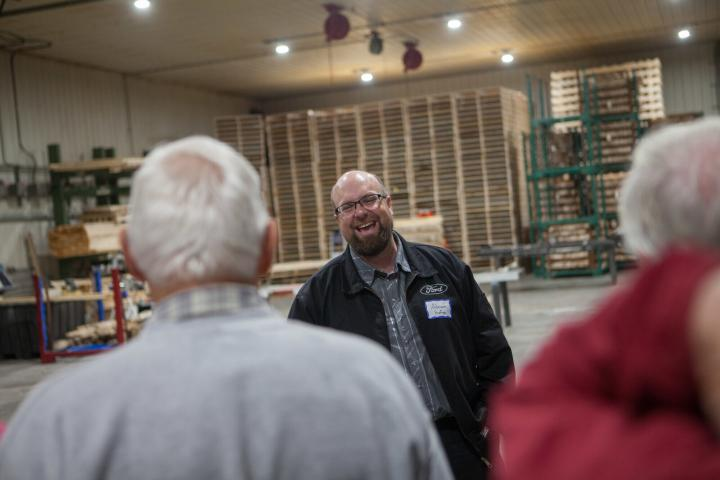 Adrian Hofer leads a guest group on a tour of Silverwinds' fabrication shop at the 2019 harvest celebration.