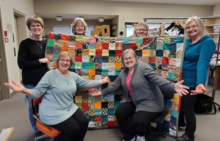 Volunteers at the Sargent MCC Thrift Shop show off the comforter they finished for the Great Winter Warm-up. Pictured are: (back row, left to right)Ruth Ens, Lillian Dyck, Marianne Sobie and Carolynne Kornelsen and (front row, left to right) Esther Fransen and Betty Rempel.