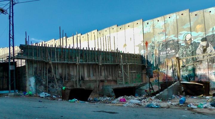Graffiti covers the wall encasing the AidaRefugee Camp.