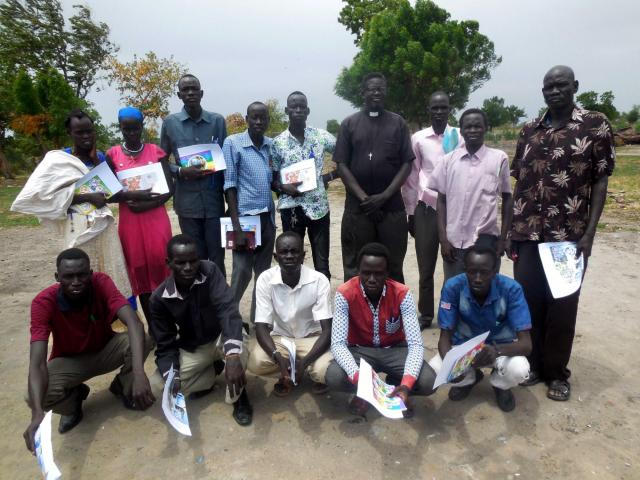 Volunteers to distribute relief supplies pose for a photo after training in Unity State