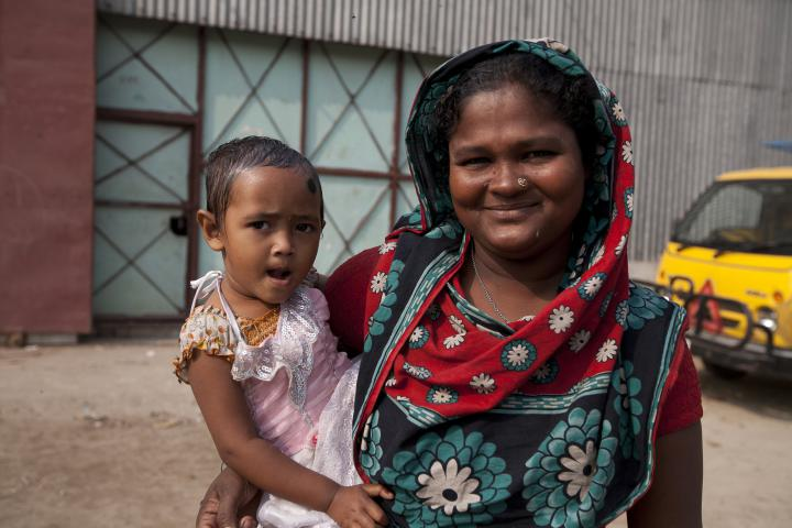 Rina Akter and her three-year-old daughter, Rabiya. Rina is a waste resource worker at the Dhaka landfill in Bangladesh. MCC provided HIV/AIDS awareness training to about 30 women, including Akter. MCC works in partnership at the landfill with Gram Bangla Unnayan Committee (Committee for the Village Development of Bangladesh).