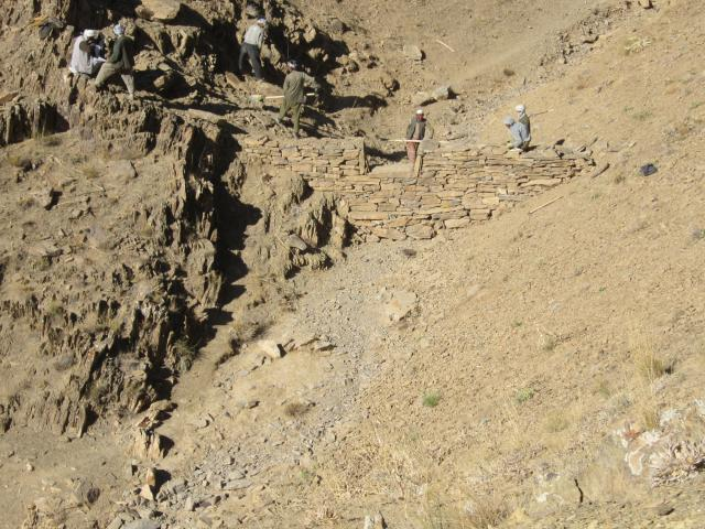 This is the Central Highlands area of Afghanistan where MCC will work in partnership with Medair. This photo shows check dams under construction,which will conserve rainwater and snow melt, and help prevent soil erosion.