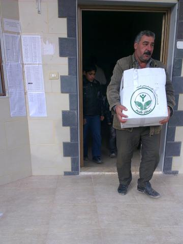Ahmad Yousef was displaced from Koseir, a village near Homs, Syria; he now lives in Humaira, where he received this food package.