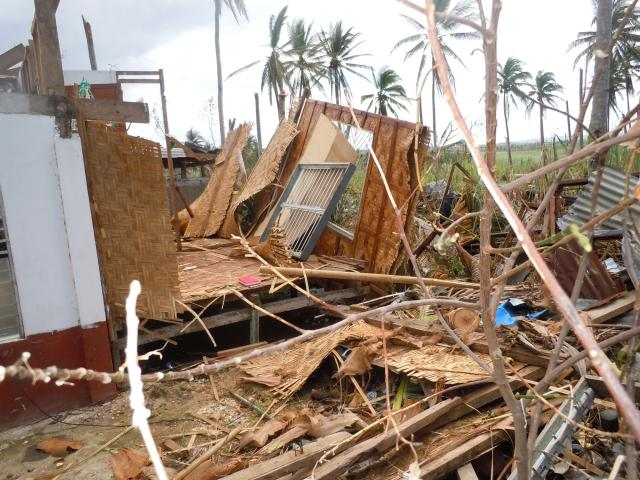 Typhoon Haiyan left few buildings intact in the village of Dalinding on the island of Cebu, Philippines. MCC area directors for southeast Asia Dan and Jeanne Jantzi visited Nov. 19.