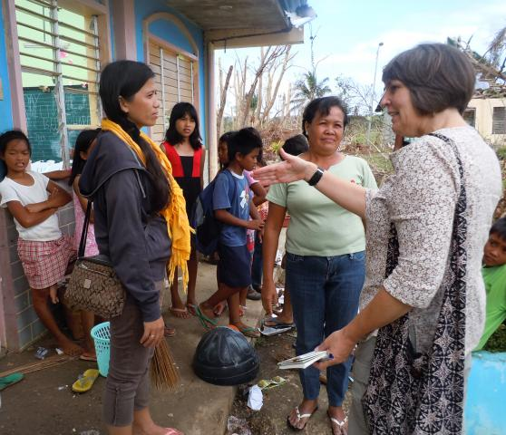 Jeanne Jantzi, right, talks with teachers Janett Yubal, left, and Selvia Luna, centre, about their experience with Typhoon Haiyan. Community members took shelter in the Dalinding village elementary school on the island of Cebu, until the winds blew away large swaths of roof.