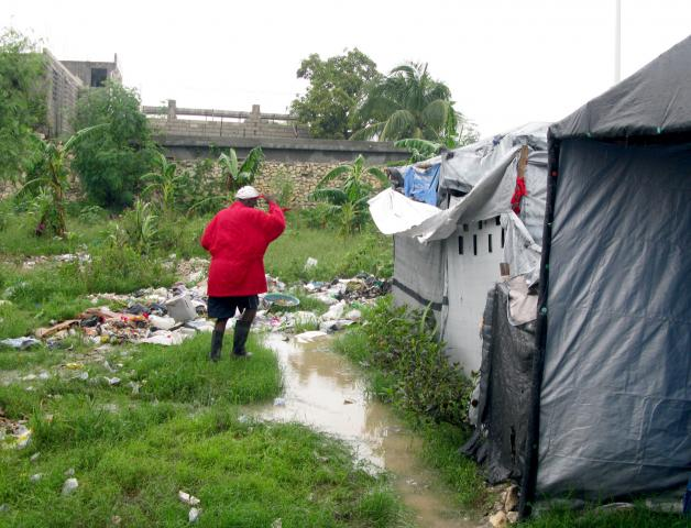 Camp Trazily, about three miles south of Port-au-Prince, was flooded by the rain caused by Hurricane Sandy. More than 370,000 people have been living in tents since the January 2010 earthquake.
