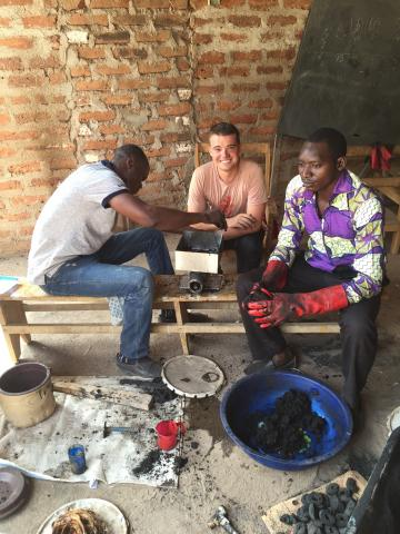 Aquilas Dadje, Nathan Schmidt and Ghislain Rodoumbaye test a new eco-charcoal mixture.