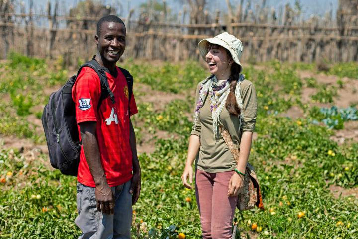 Rebecca Standen and Chadreque Finiasse stand in a field